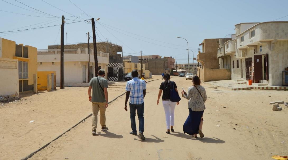 Students walk through a local community during their Human Rights internship in Senegal.